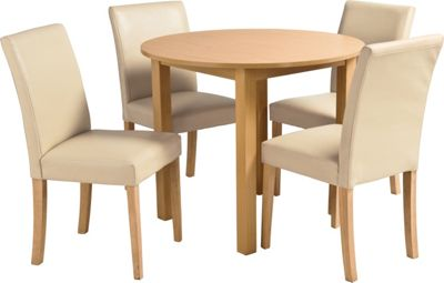Elmdon Oak Circular Dining Table and 4 Cream Chairs.