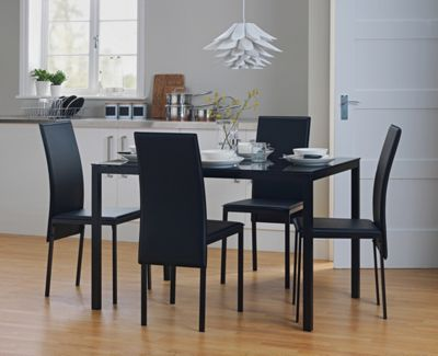 Homebase garcia glass dining table and 4 black chairs for Top rated dining tables
